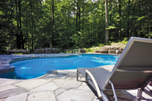 Custom inground pool installed by Waide's Pools & Spas in Erie, PA.