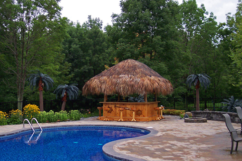 Waterford, PA beautiful pool accompanied by outdoor living area with grill, bar and outdoor leisure furniture.