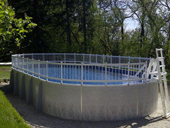 Oval above ground swimming pool.