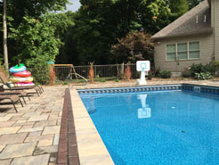Completed Waide's pool installation and accessories including pool loungers and pool toys.