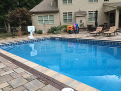 Shown: Large Rectangular in ground pool with crystal clear water and pool lounges.