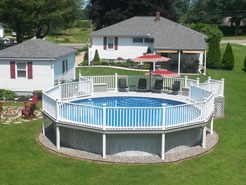 Round above ground pool with large deck shown.