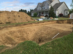 Early stage of pool installation include choosing a spot and preparing it for the concrete to be poured.