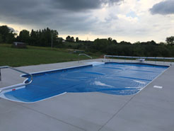 Shown Waide's Pools and Spas completed pool installation.  Pool is covered with solar heater.