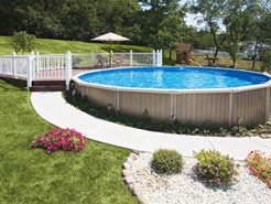 Small round semi in-ground pool with attached deck.